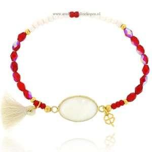 armband witte steen glimmende rode steentjes