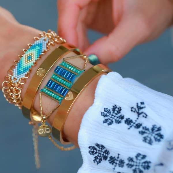 armbandje staal met kralen goud blauwe tinten online kopen
