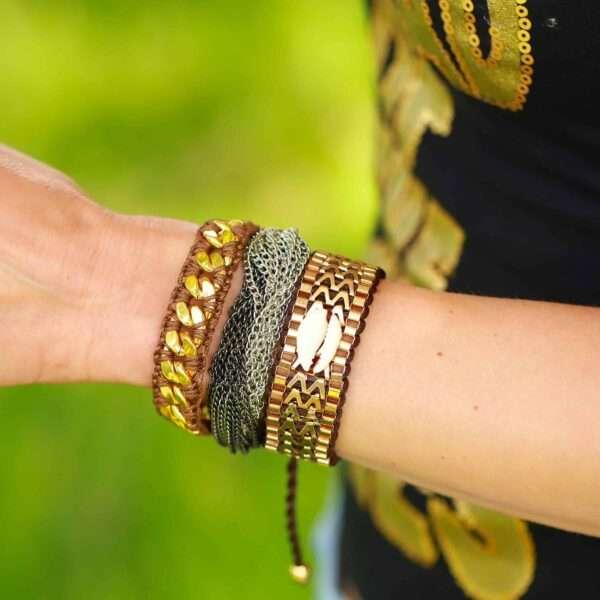 briun goud armbanden met schelp