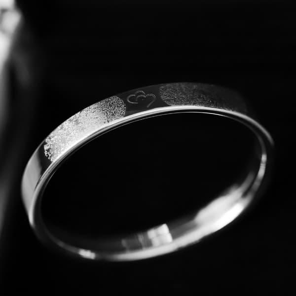 Zilveren armband verbonden hartjes met vingerafdruk